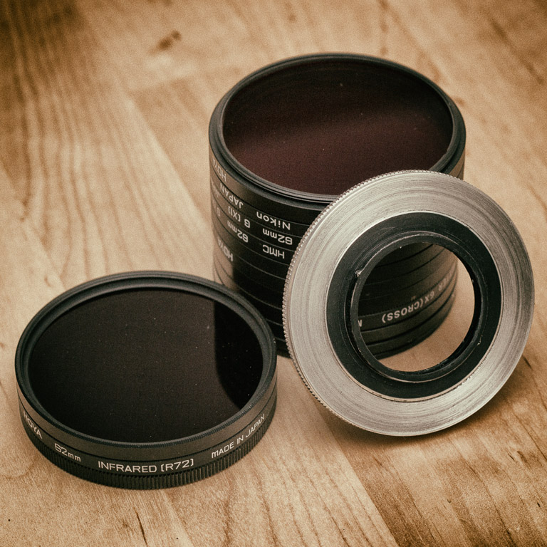 A stack of 62mm filters with a Flexaret Filter Adapter.